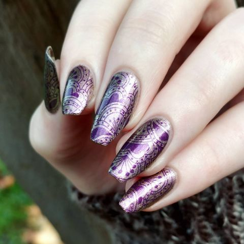 Plum and metallic nails with o