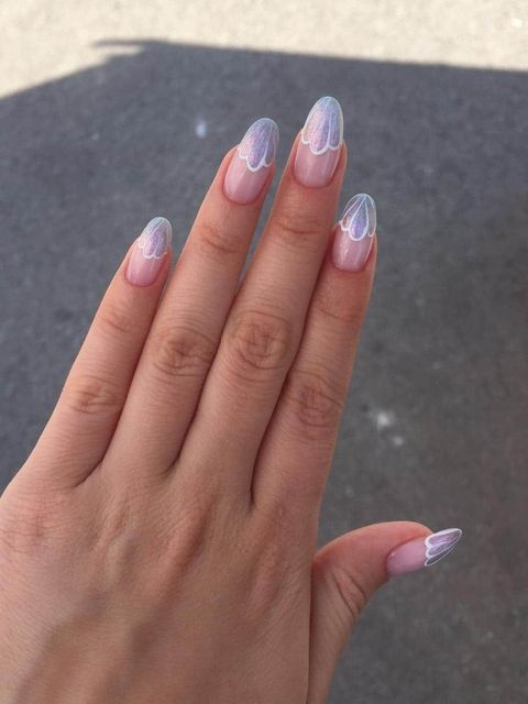Gel pink and white nails with a petal and a touch of glitter